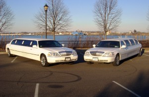 Two 10 Passenger White Limos